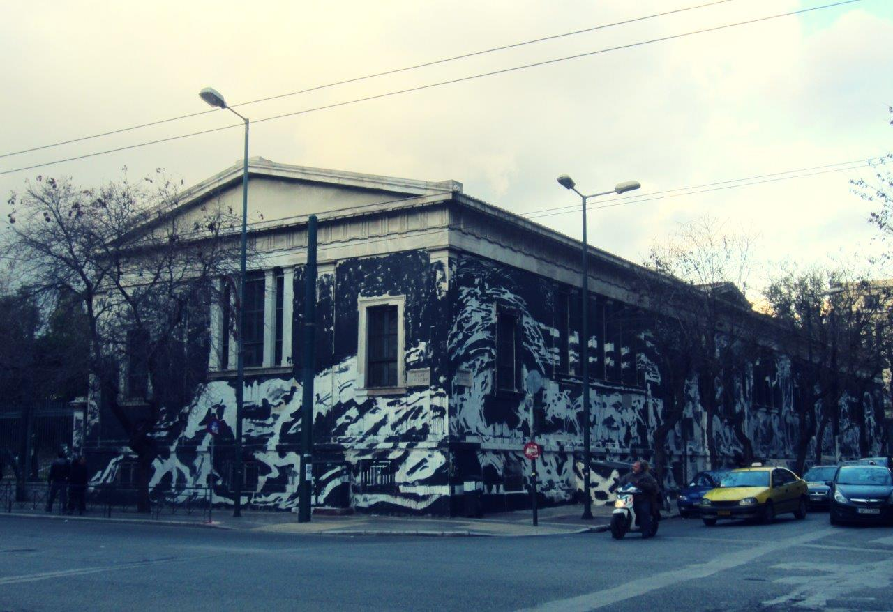 Large graffitti covering the Athens Polytechnic University in March 2015