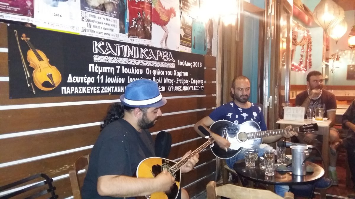 Rebetiko musicians playing traditional music during a private tour in Athens