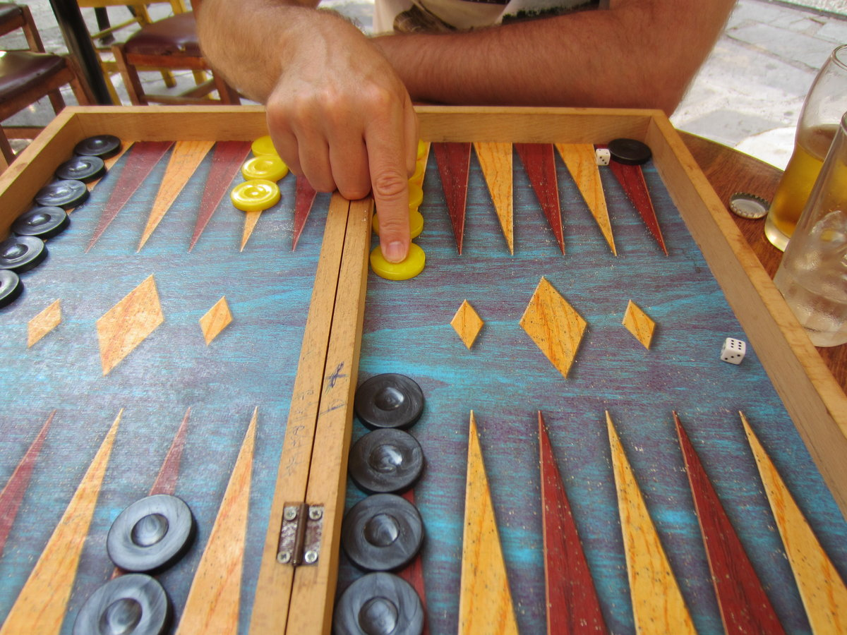 Playing tavli with a local in Athens on a private tour of the city