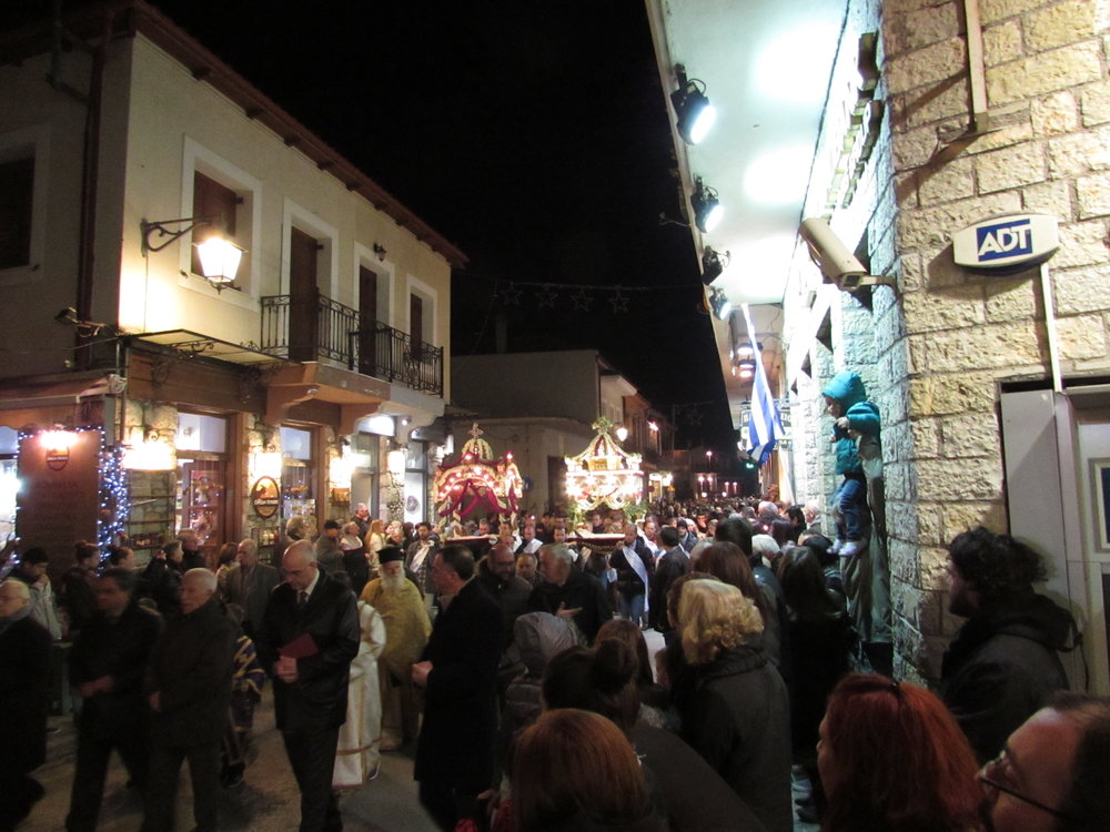 A procession through the streets of a small town during Easter in Greece
