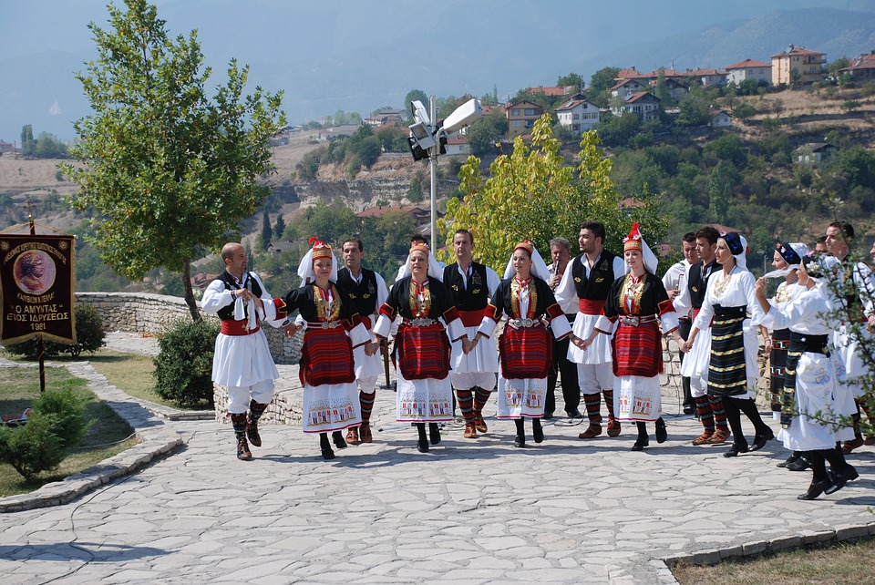 Greeks dancing in traditional costume