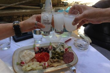 Enjoying Greek drinks on vacation