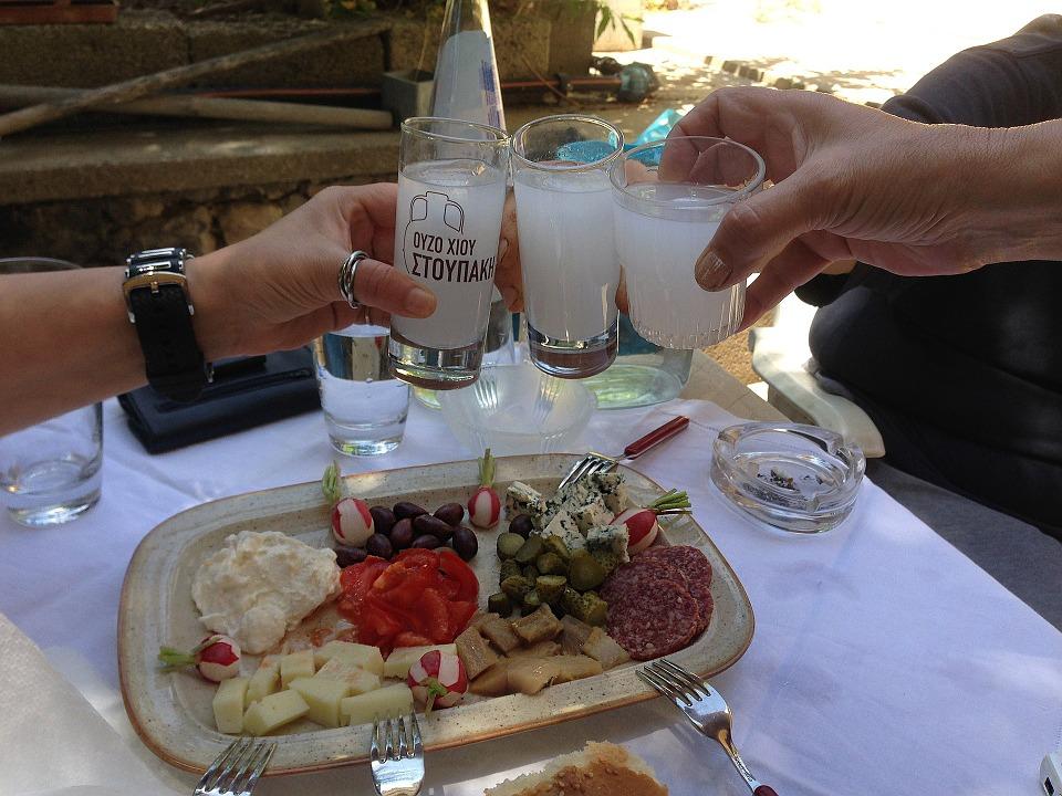Enjoying Greek drinks on vacation