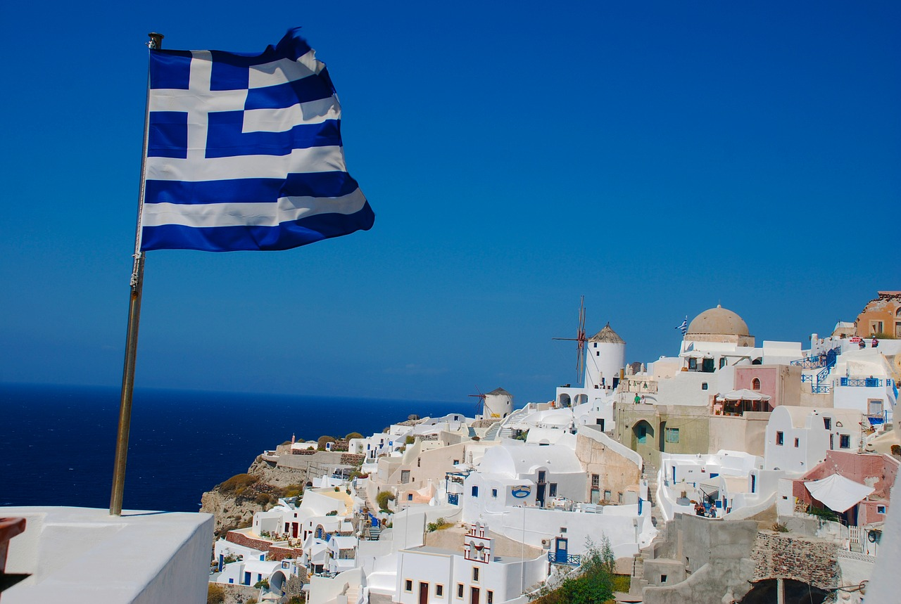 A view of Santorini complete with Greek flag