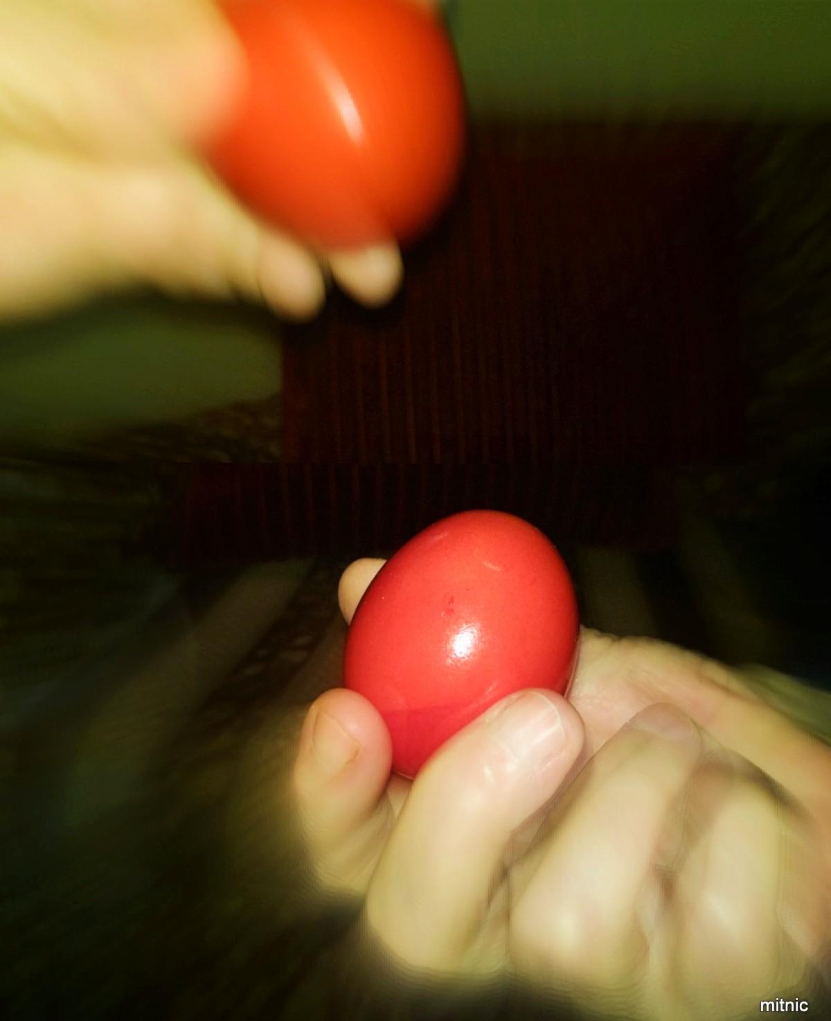 Cracking red Eggs for Greek Easter