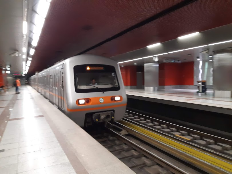 A metro train arriving at an Athens underground station
