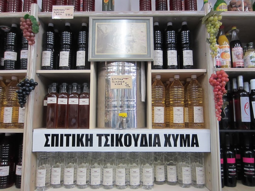 Food market in Athens - Bottles of wine and raki