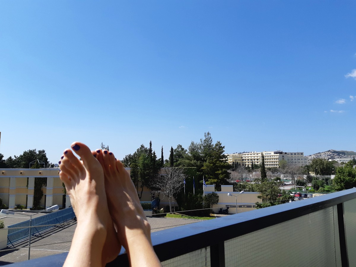 Enjoying the sun on the balcony