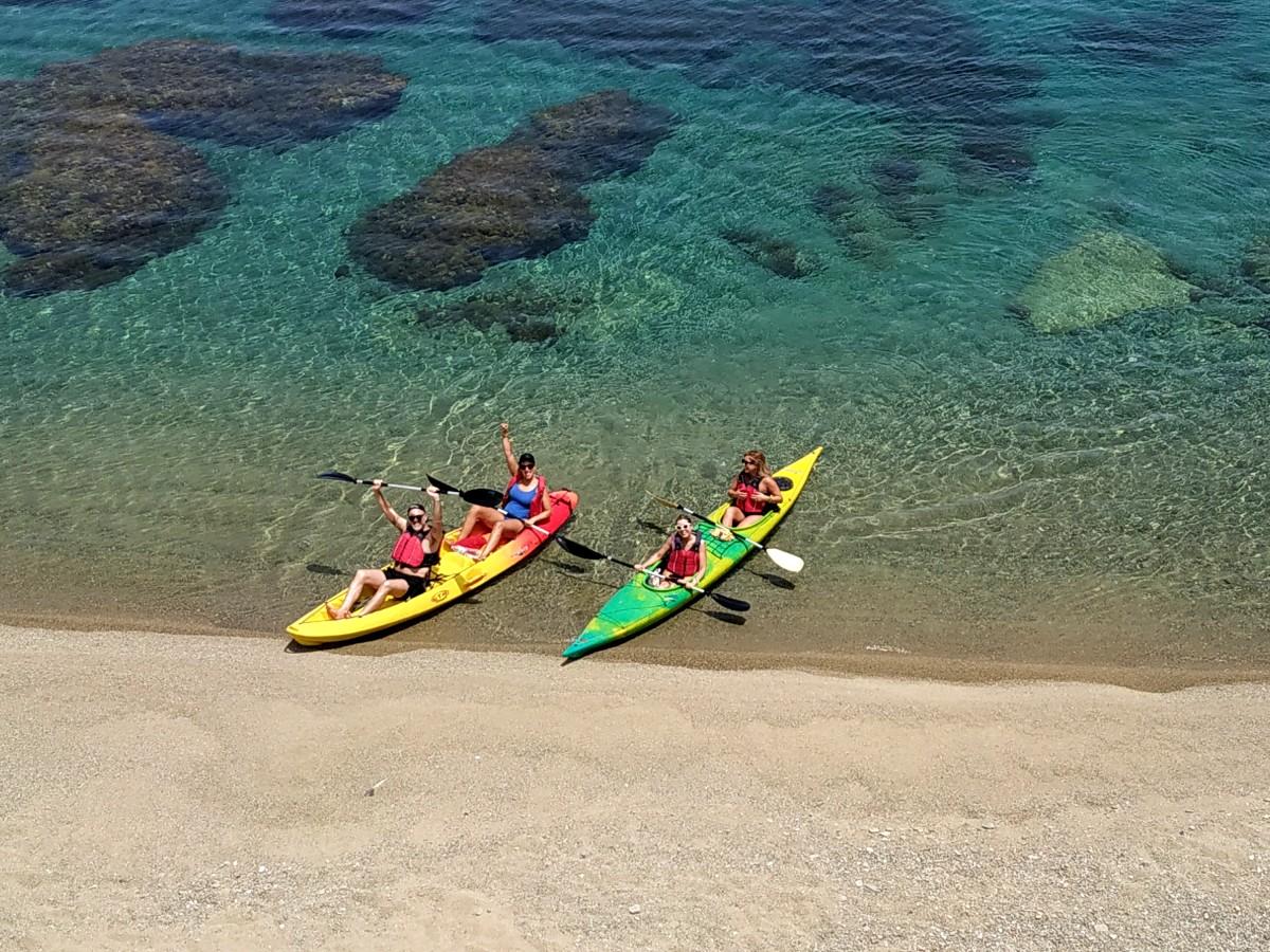 Kayaks on a sandy Mykonos beach