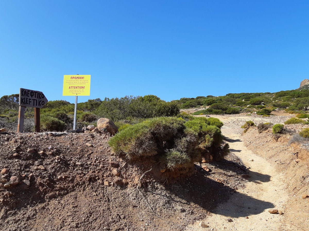 Sign to the walking path to Kleftiko beach Milos Greece