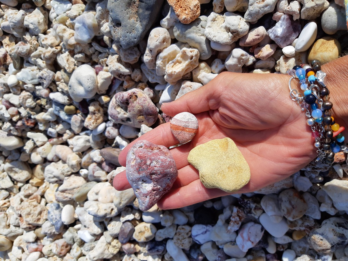 Colourful stones on Kastanas beach Milos Greece