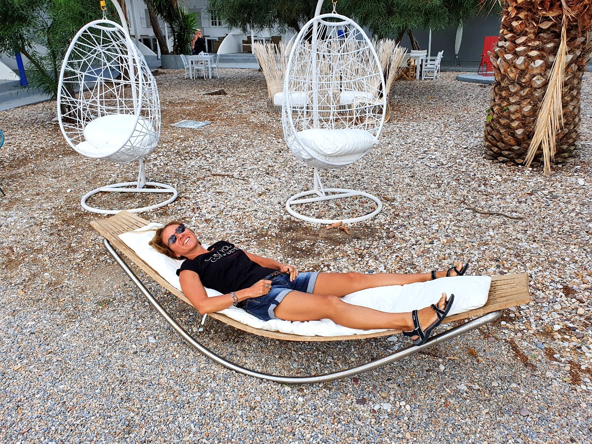 Kimolos Greece is a relaxing island - Vanessa from Real Greek Experiences relaxing on a lounger!