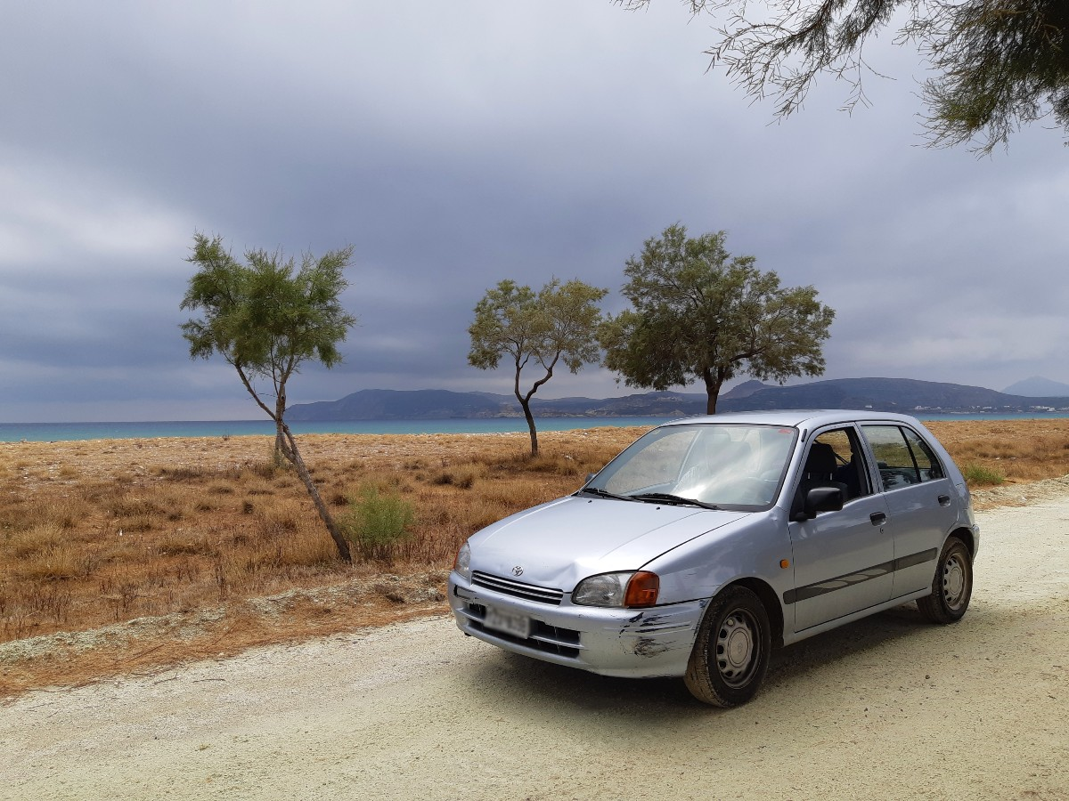 Real Greek Experiences - Our car by the beach in Kimolos Greece