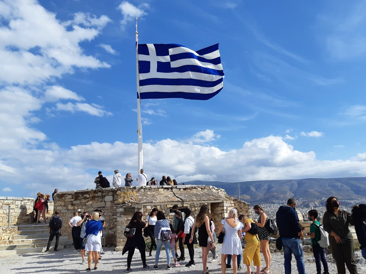 The Greek flag on the Acropolis rock