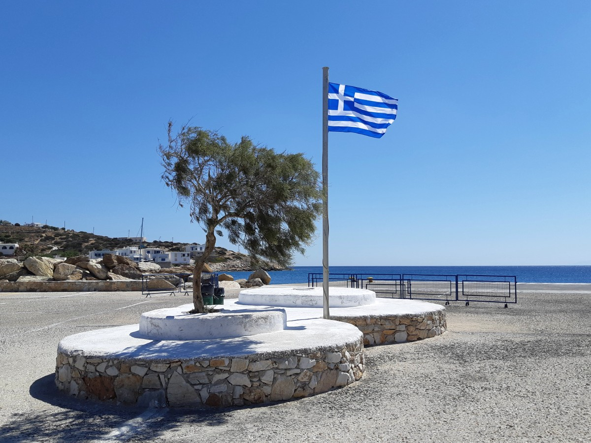 A Greek flag in the port town in Sikinos