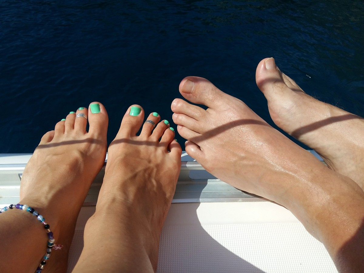 Putting our feet up on the sailing trip around Milos