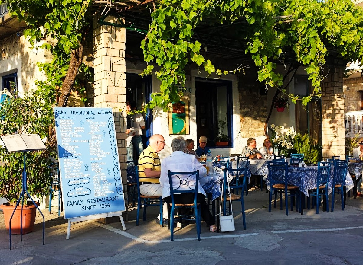 People sitting at a taverna in Greece