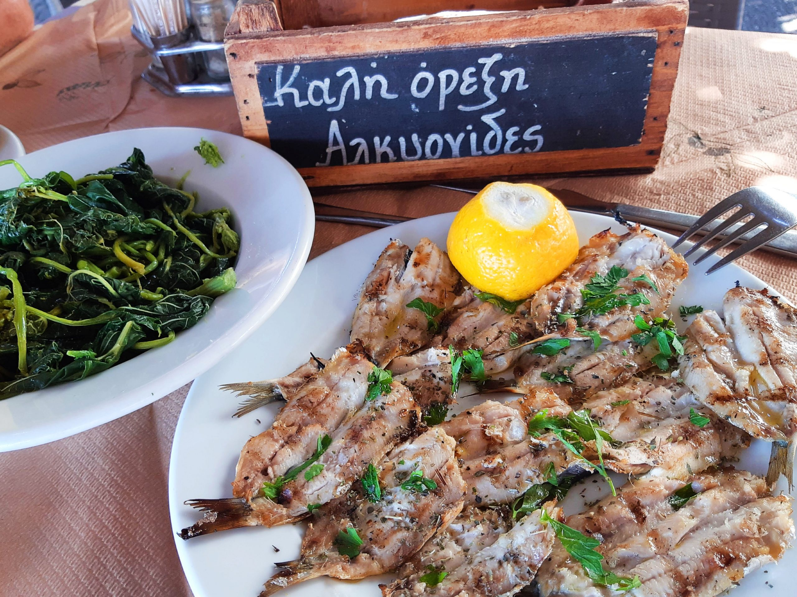 Grilled sardines served with horta